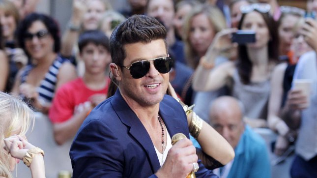 Robin Thicke performs on the NBC Today Show at Rockefeller Center. Thicke has sued the family of Marvin Gaye and the owner of several Funkadelics songs to shield his hit from legal action. UPI/John Angelillo