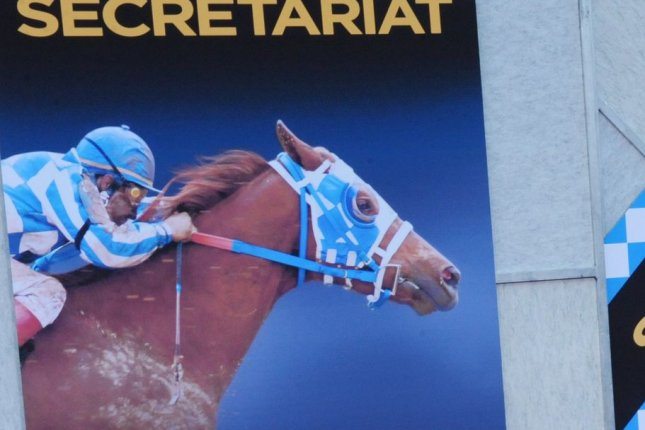 Secretariat, winner of horse racing's Triple Crown in 1973, is pictured on a poster at the premiere of the movie Secretariat Sept. 20, 2010. The big chestnut colt's jockey in the three races -- the Kentucky Derby, Preakness and Belmont Stakes -- was Ron Turcotte. File Photo by Jim Ruymen/UPI