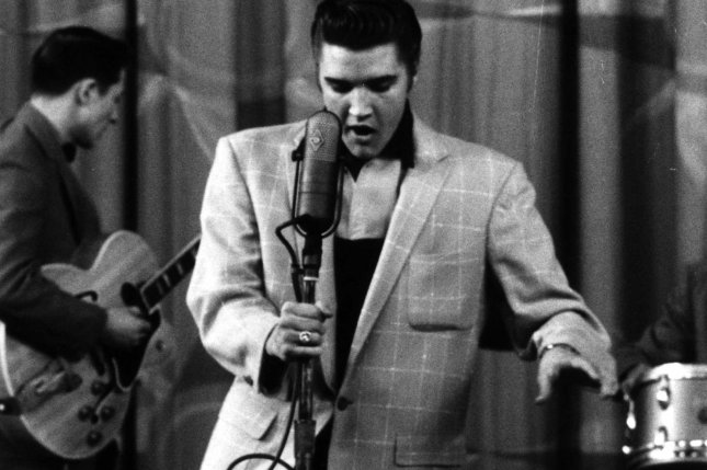 "Elvis Presley performs in a show in 1956. On Sept. 9 of that year, Presley made his first appearance on national television – on ""The Ed Sullivan Show."" File Photo/UPI"
