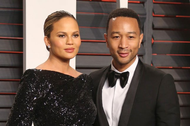 Chrissy Teigen (L) and John Legend at the Vanity Fair Oscar party on February 28. The couple married in 2013. File Photo by David Silpa/UPI