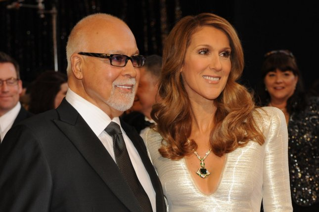 Celine Dion (R) and René Angélil at the Academy Awards on February 27, 2011. Angélil died at age 73 in January. File Photo by Jim Ruymen/UPI