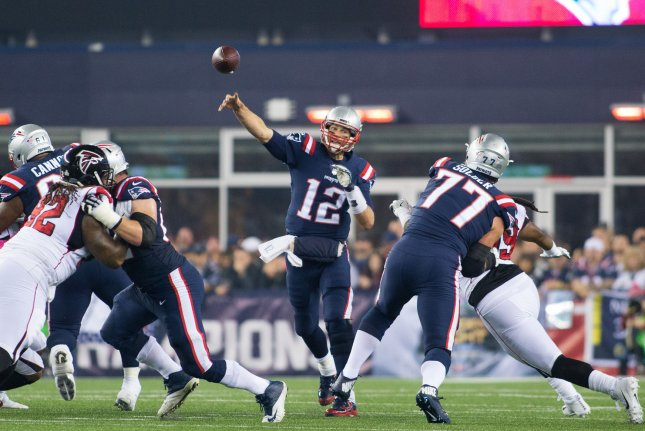 New England Patriots quarterback Tom Brady (12) throws a pass in the the first quarter against the Atlanta Falcons at Gillette Stadium in Foxborough, Massachusetts on October 22, 2017. File photo by Matthew Healey/UPI