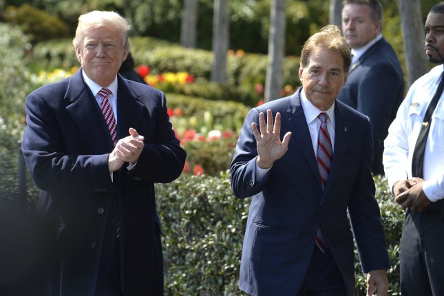 President Donald Trump (L) arrives with University of Alabama Head Coach Nick Saban for a ceremony to honor players from the NCAA National Champion Crimson Tide football team on April 10, 2018 during a visit to the White House in Washington, DC. Photo by Mike Theiler/UPI
