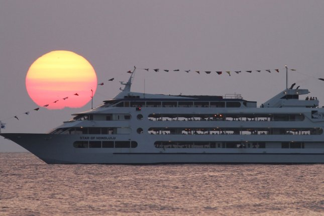A cruise liner passes in ocean waters off Ala Moana Beach Park in Honolulu, Hawaii. File Photo by Cory Lum/UPI
