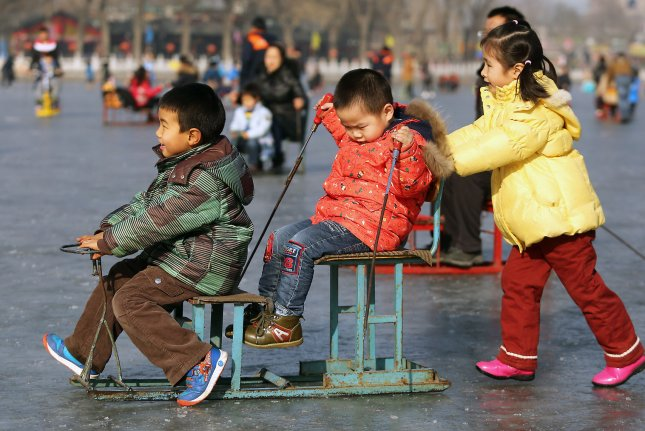 Families visit a frozen lake to skate, ski, slip and fall at a popular tourist area in Beijing on February 6, 2015. On October 29, 2015, China announced it was ending its nearly 40-year one-child policy, allowing couples to have two children without facing punishment. File Photo by Stephen Shaver/UPI