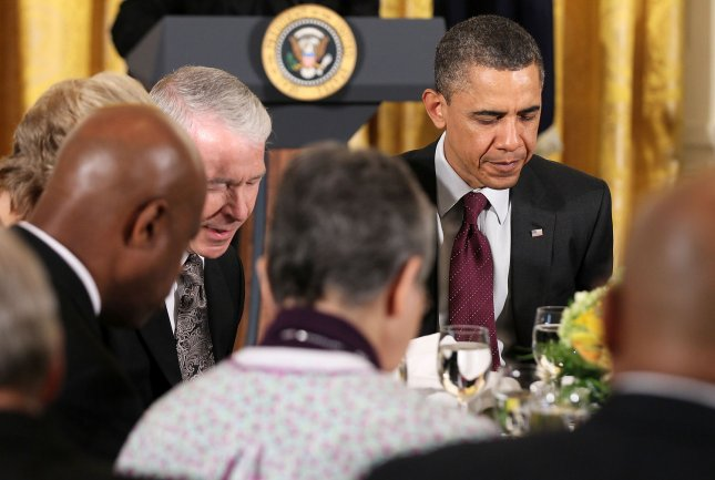 U.S. President Barack Obama (R) participates in an Easter Prayer Breakfast in the East Room of the White House in Washington, April 19, 2011. Obama hosted Christian leaders from across the country for a time of prayer, reflection, and celebration of the Easter. UPI/Alex Wong/Pool