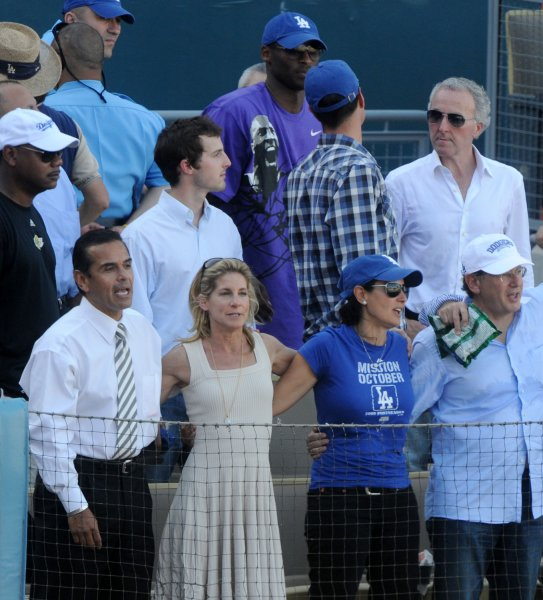 Los Angeles Dodgerss' CEO Jamie McCourt (2nd-L) sings Take Me Out to the Ballgame with LA Mayor Antonio Villaraigosa (L) as her husband, Dodgers' owner Frank McCourt, upper right, looks on during Game 2 of the National League championship series at Dodger Stadium in Los Angeles on October 16, 2009. The Dodgers defeated the Philies 2-1. UPI/Jim Ruymen