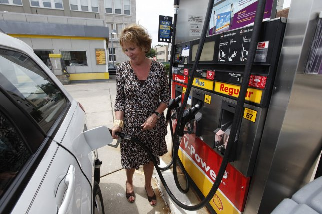 Debra Potter fills up at a gas station in Chicago on July 15, 2009. (UPI Photo/Brian Kersey)