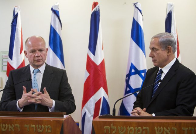 Britain's Foreign Secretary William Hague (L) stands next to Israeli Prime Minister Benjamin Netanyahu as they deliver joint statements before their meeting in Jerusalem May 23, 2013. UPI/Ronen Zvulun/Pool