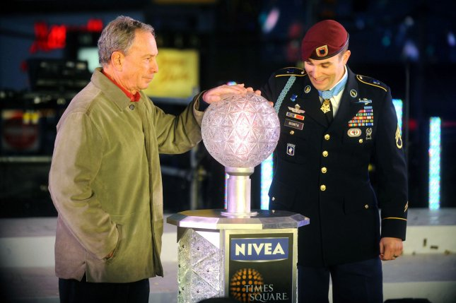 Medal of Honor recipient, Army Staff Sgt. Salvatore Giunta and Mayor Michael Bloomberg put their hands on a miniature New Years ball in Times Square in New York, Jan. 1, 2011. UPI/Dennis Van Tine