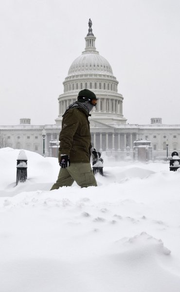 A man walks in front of the U.S. Capitol building in Washington on February 6, 2010 during heavy snow fall. The snow storm is expected to be the largest the Nation's Capital has seen. UPI/Madeline Marshall