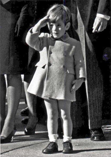 WASHINGTON, DC, USA: Little John F. Kennedy, Jr., salutes, November 25, 1963, as the casket containing the body of his father, President John F. Kennedy is taken from St. Matthews' Cathedral during funeral services. (UPI PhotoFiles)