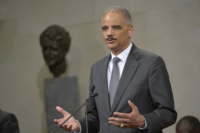 U.S. Attorney General Eric Holder delivers remarks at a ceremony horning the 50th Anniversary of the signing of the Civil Rights Act and the formation of the Community Relations Service, at the Department of Justice in Washington, D.C. on July 14, 2014. UPI/Kevin Dietsch