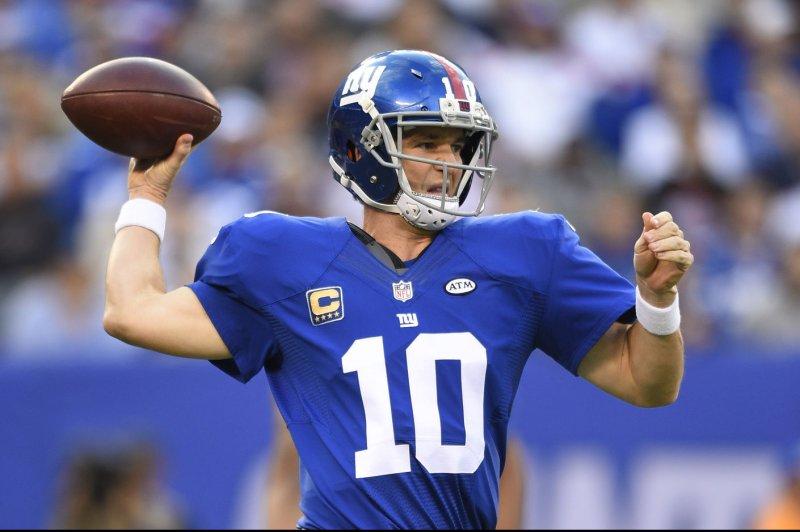 New York Giants quarterback Eli Manning (10) attempts a pass. UPI/Rich Kane