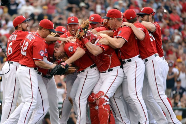 The Washington Nationals celebrate Max Scherzer's no-hitter against the Pittsburgh Pirates at Nationals Park on June 20, 2015 in Washington, DC. Photo by Pat Benic/UPI