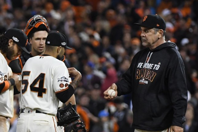 San Francisco Giants manager Bruce Bochy (R) hands the ball to reliever Sergio Romo, the third of five pitchers he employed to blow a three run lead in the ninth inning of in National League Division Series against the Chicago Cubs at AT&T Park in San Francisco on October 11, 2016. The Cubs defeated the Giants 6-5 to win the NLDS. Photo by Terry Schmitt/UPI