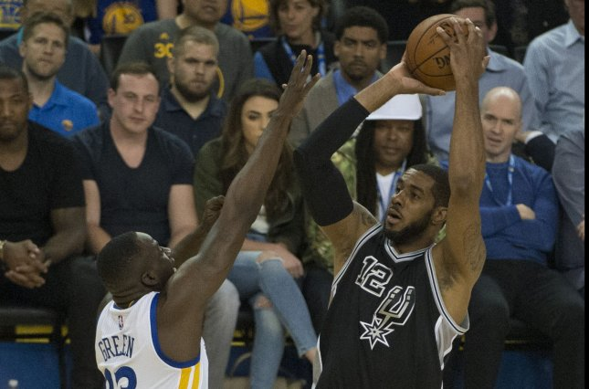 San Antonio Spurs power forward Lamarcus Aldridge (12) puts up a shot against the Golden State Warriors on April 7, 2016. Photo by Terry Schmitt/UPI