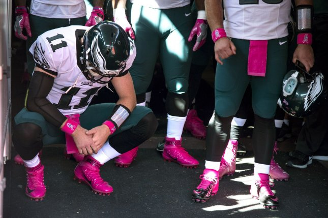 Philadelphia Eagles quarterback Carson Wentz (11) waits off the field prior to the Eagles game agains the Washington Redskins at FedEx Field in Landover, Maryland on October 16, 2016. Photo by Kevin Dietsch/UPI