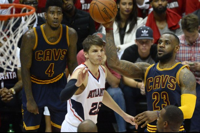 4d85b84b3af7 Cleveland Cavaliers  LeBron James (23) shoots a basket over Atlanta Hawks  Kyle  Korver (26) as Cleveland s Iman Shumpert (4) watches during the second half  ...
