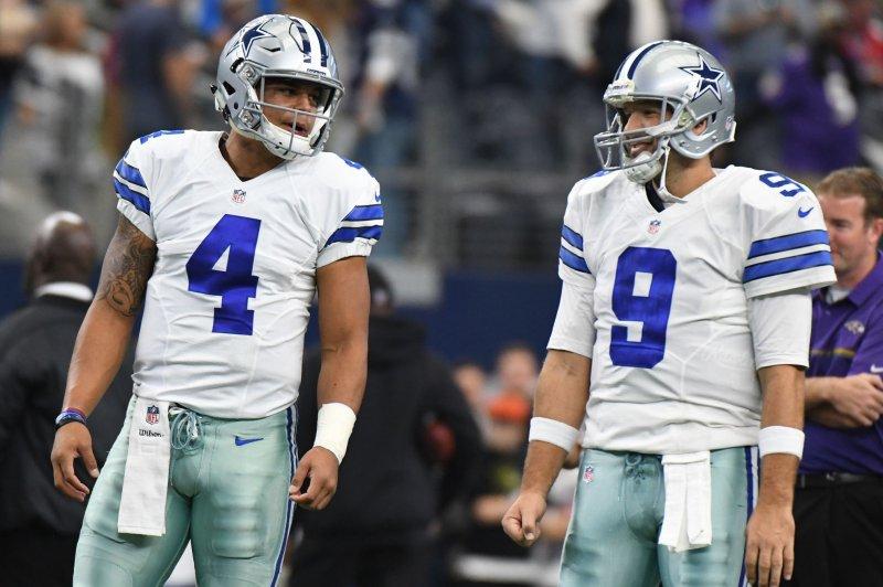 Dallas Cowboys quarterbacks Tony Romo, right, and Dak Prescott warms up prior to facing the Baltimore Ravens on November 20, 2016 at AT&T Stadium in Arlington, Texas. Prescott has started in place of Romo all season.. Ian Halperin/UPI