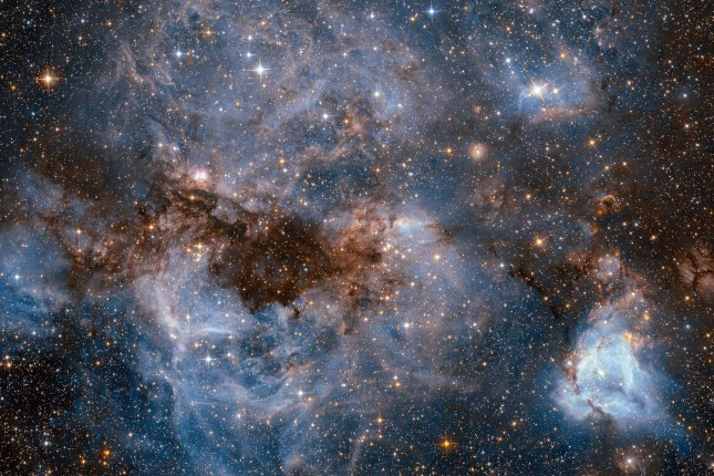 Researchers suggest links between the distribution of matter across the vast universe and the cosmos' smallest particles could reveal new modes of physics. Photo by NASA/UPI