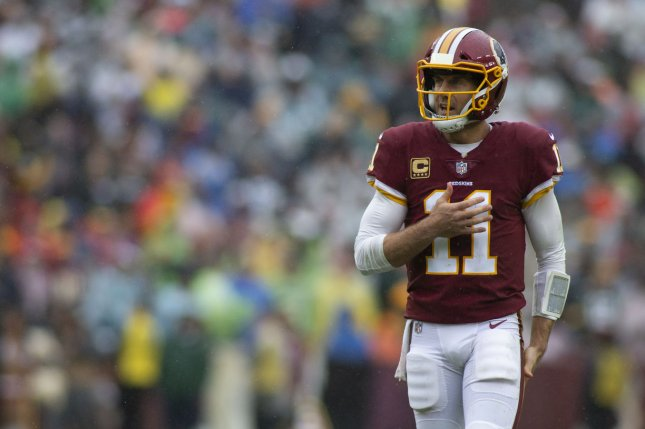 816e9e77a Washington Redskins quarterback Alex Smith (11) pats his chest after  throwing an incomplete pass during an NFL Week 3 game between the  Washington Redskins ...
