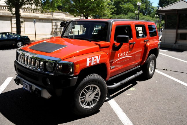 A 100 MPG hybrid electric Hummer, designed by Raser Technologies, is seen on display near the U.S. Capitol Building in Washington on May 20, 2009. Raser Technologies said that their technology could be adapted for almost any SUV or truck. (UPI Photo/Kevin Dietsch)