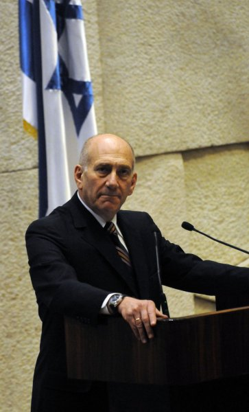 Outgoing Israeli Prime Minister Ehud Olmert speaks in the Knesset before Prime Minister-Designate Benjamin Netanyahu presents his new right-wing government, March 31, 2009, Jerusalem.(UPI Photo/Debbie Hill)