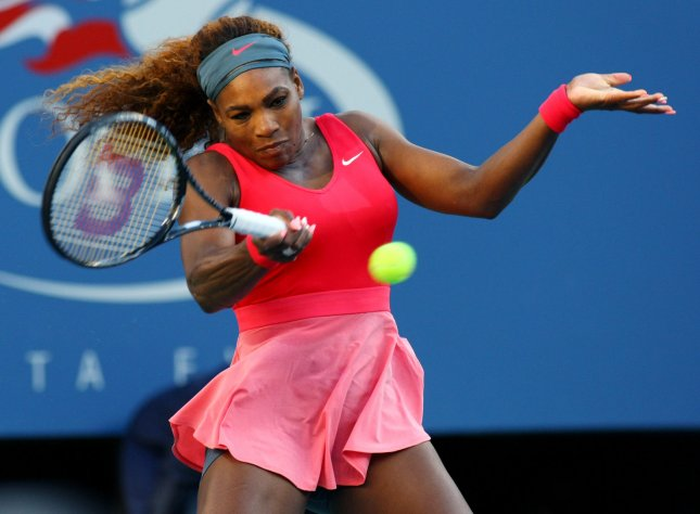 Serena Williams, shown at last year's U.S. Open, on Wednesday posted her 60th career win at the Australian Open, tying the women's single record set by Margaret Court. Williams was a straight-set winner Wednesday and advanced to the third round in tying the record. UPI /Monika Graff