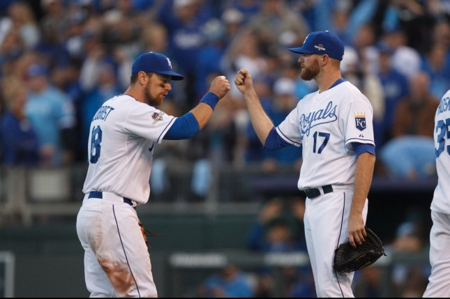 Kansas City Royals second baseman Ben Zobrist (18) and relief pitcher Wade Davis (17) bump fists after defeating the Houston Astros in game 2 of the American League Division Series at Kauffman Stadium in Kansas City, Missouri on October 9, 2015. Photo by Jeff Moffett/UPI