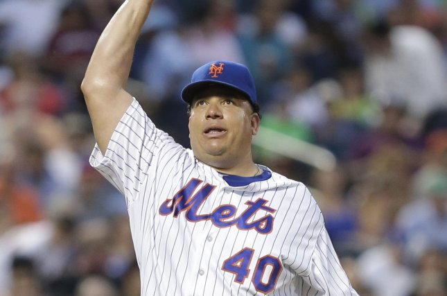 New York Mets starting pitcher Bartolo Colon walks to the dug out after the 4th inning against the Washington Nationals at Citi Field in New York City on July 7, 2016. Photo by John Angelillo/UPI