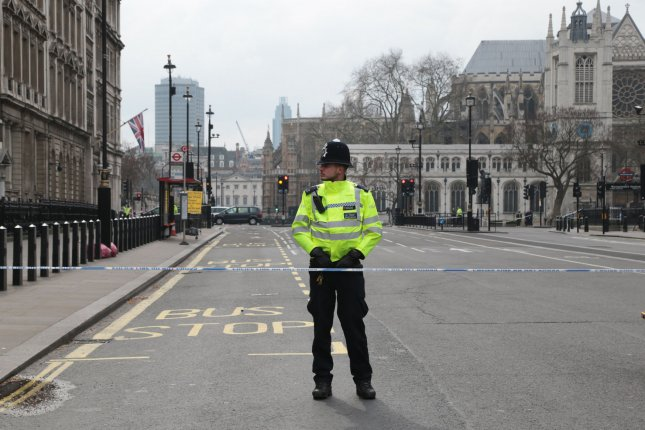Metropolitan Police remain vigilant and roads remain closed and cordoned off around Westminster after yesterday's terrorist attack on Westminster bridge and the Houses of Parliament where four victims died and 40 people were injured in London on Wednesday. The British home minister called for access to end-to-end encrypted messaging services after it was revealed the attacker used WhatsApp 2 minutes prior to the attack. Photo by Hugo Philpott/UPI