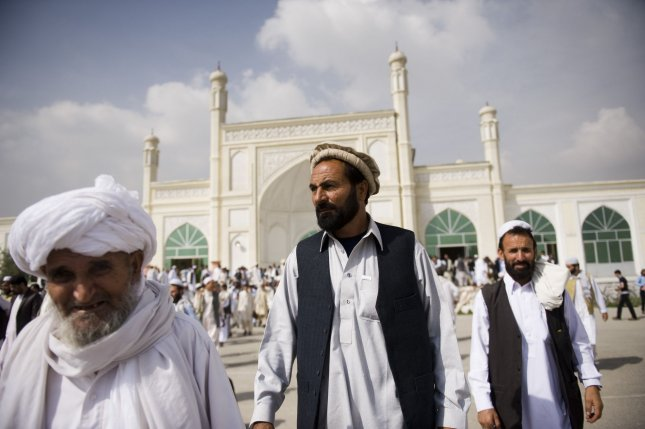 Afghan men walk outside the Eid Gah mosque for Eid al-Fitr prayers in Kabul on September 10, 2010. The Eid festival, marking the end of the fasting month of Ramadan, has been declared on September 10 for most parts of the world including Afghanistan. Eid al-Fitr celebrates the purification achieved by a month of sunrise-to-sunset fasting, one of the five pillars of Islam, and is marked by several days of festivities. UPI/Hossein Fatemi.