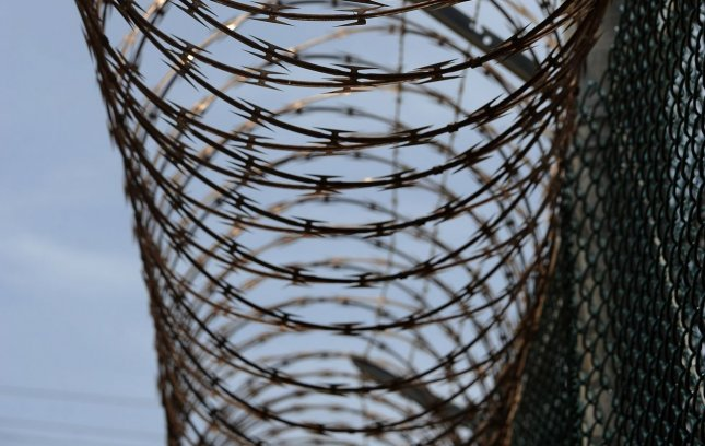 Razor wire is seen in Camp IV in Camp Delta at Naval Station Guantanamo Bay in Cuba on July 8, 2010. UPI/Roger L. Wollenberg