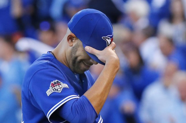 Toronto Blue Jays starting pitcher David Price covers his face after giving up four Kansas City Royals runs in the seventh inning of game 2 of the American League Championship Series at Kauffman Stadium in Kansas City, Missouri on October 17, 2015. Price took the loss as he served up five earned runs in the inning. Photo by Kyle Rivas/UP