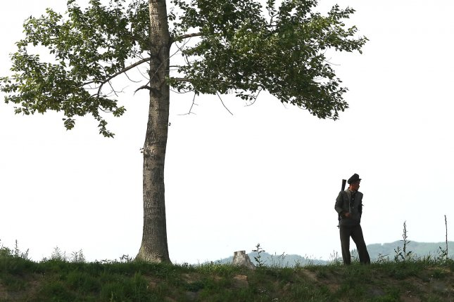 A North Korean soldier patrols the border last May near Sinuiju, across the Yalu River from Dandong, China's largest border city with North Korea. Chinese guards are acting as 24-hour lookouts in case of North Korea provocations, a Hong Kong-based NGO said. File photo by Stephen Shaver/UPI
