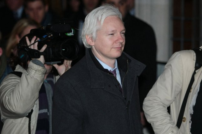 Wikileaks founder Julian Assange leaves the Supreme Court in London after a 2012 hearing to avoid extradition to Sweden. Photo by Hugo Philpott/UPI