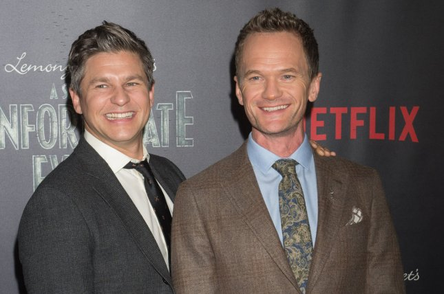 Neil Patrick Harris (R) with David Burtka. The actor was told what to say and do while shopping at Target during a segment on The Ellen DeGeneres Show. File Photo by Bryan R. Smith/UPI