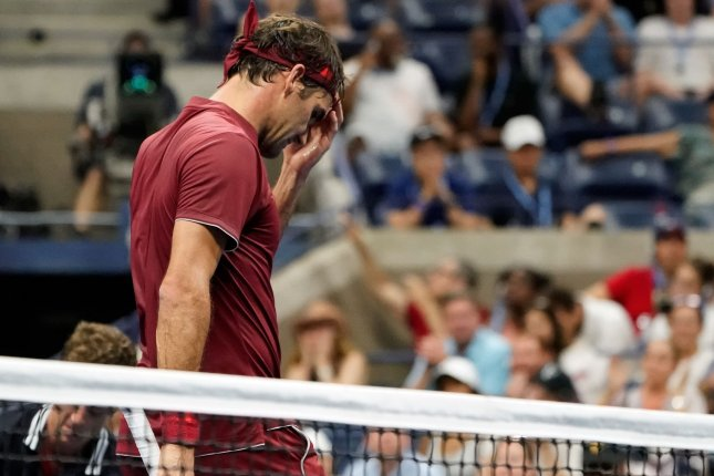 Roger Federer of Switzerland reacts after losing a game to John Millman of Australia in their 4th round match in Arthur Ashe Stadium at the 2018 US Open Tennis Championships on Monday at the USTA Billie Jean King National Tennis Center in New York City. Photo by Ray Stubblebine/UPI