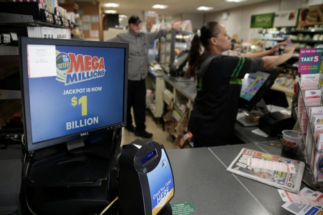 A monitor at a lottery location in New York City displays Friday's New York Mega Millions jackpot which hit $1 billion. Photo by John Angelillo/UPI