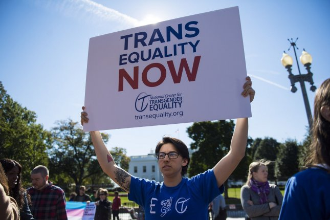 Transgender rights activists protest the Trump administration in October. The Trump administration seeks to ban most transgender people from serving in the military. File Photo by Kevin Dietsch/UPI