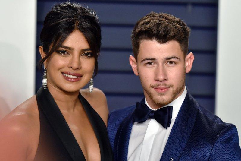 Nick Jonas (R) with his wife Priyanka Chopra. Nick is reforming The Jonas Brothers with his siblings Joe Jonas and Kevin Jonas. Photo by Christine Chew/UPI