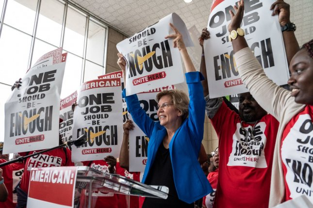 Democratic presidential candidate Elizabeth Warren supports airline workers Tuesday at Reagan National Airport. Photo by Ken Cedeno UPI