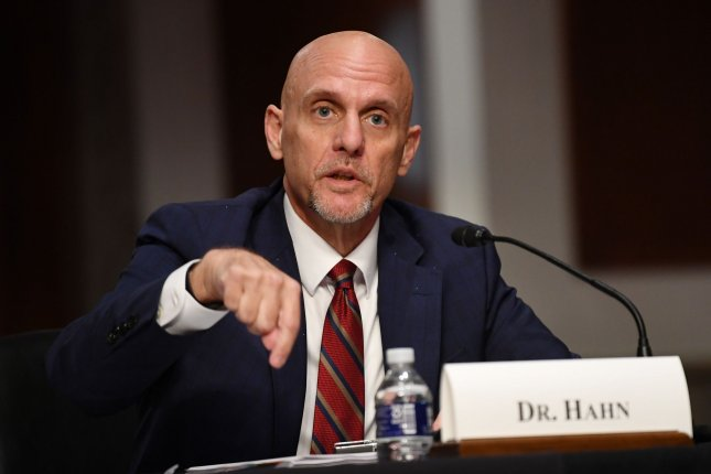 Food and Drug Administration Commissioner Stephen Hahn on Sunday said the agency would consider issuing an emergency use authorization for a COVID-19 vaccine ahead of stage three clinical trials. File Photo by Kevin Dietsch/UPI