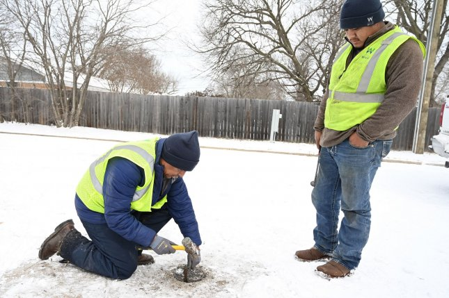 Public works crews work to repair broken water lines in Wylie, Texas on February18. Photo by Ian Halperin/UPI