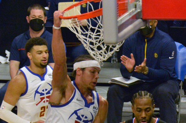 Denver Nuggets forward Aaron Gordon dunks over Los Angeles Clippers forward Kawhi Leonard in the first half of a win Thursday in Los Angeles. Photo by Jim Ruymen/UPI
