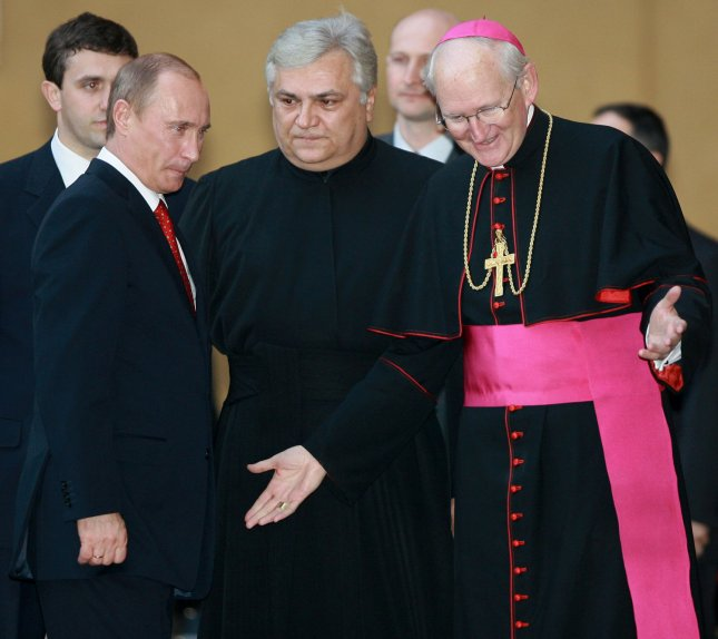 Russian President Vladimir Putin (L) is welcomed by Vatican officials as he arrived for a meeting with Pope Benedict XVI at the Vatican on March 13, 2007. The meeting, the first between Benedict and Putin, is part of a visit that takes the Russian leader to Italy and Greece this week. (UPI Photo/Anatoli Zhdanov)