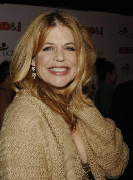 Cast member Linda Hamilton smiles as she arrives for the Los Angeles premiere of the motion picture comedy The Kid & I at Grauman's Chinese Theatre in Hollywood November 28, 2005. The movie tells the story of a teenager with cerebral palsy (Eric Gores) who dreams of starring in a big-time action movie and opens to limited release in the U.S. on December 2. (UPI Photo/Jim Ruymen)