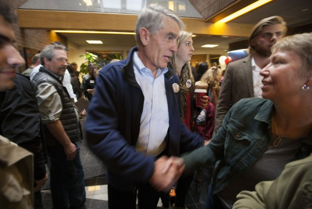 Democratic Sen. Mark Udall shakes hands after speaking to supporters at the Udall Field Office in Boulder, Colorado on November 2014. Sen. Udall begins a 5-stop bus tour accompanied by Vice President Joe Biden's wife, Dr. Jill Biden, in Boulder County, his home county, days before Election day. UPI/Gary C. Caskey