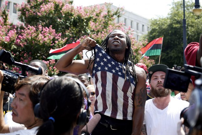 An unidentified counter-protestor shouts at a member of the Ku Klux Klan during a rally July 18, 2015, at the South Carolina State House in Columbia, South Carolina, which was held to protest the removal of a Confederate battle flag from the State House grounds. Photo by Veasey Conway/UPI